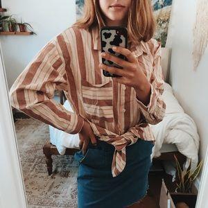 pink, orange, and cream striped blouse